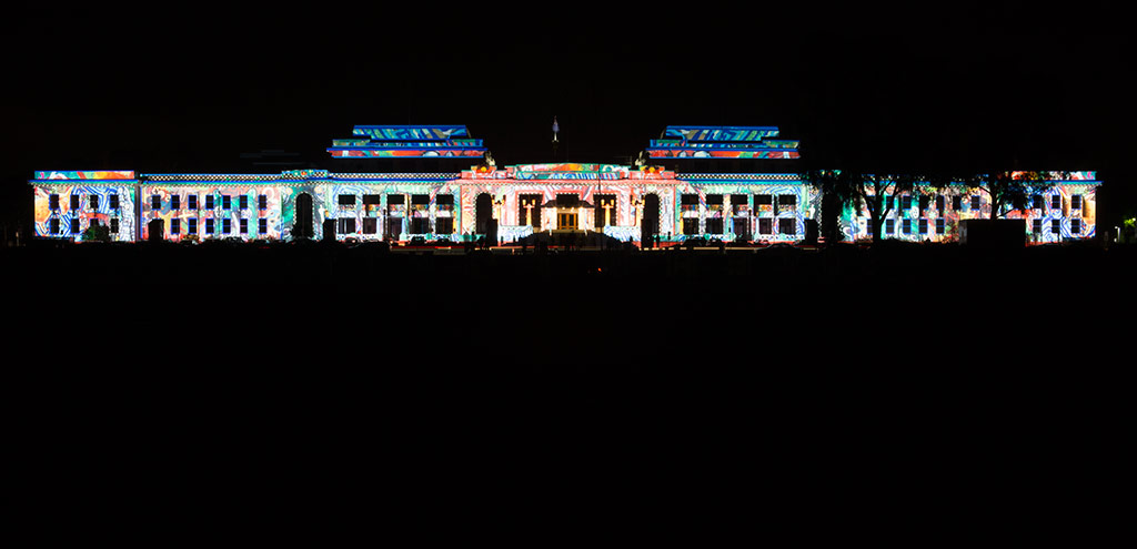 Lights are used to paint Old Parliament House with abstract images