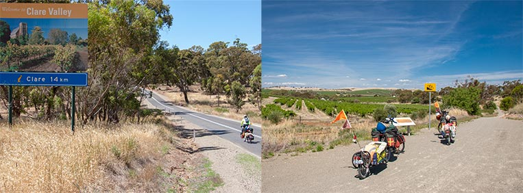 Two photos side by side. Left – a large billboard beside a bitumen road. A bicycle is travelling on the road. The billboard has a photo of vineyard and what looks like a church in the background. Text reads Welcome to Clare Valley, Clare 14km. Right – Two touring bicycles on a gravel section of the Riesling Trail. Vineyards stretch to the horizon, blue sky.